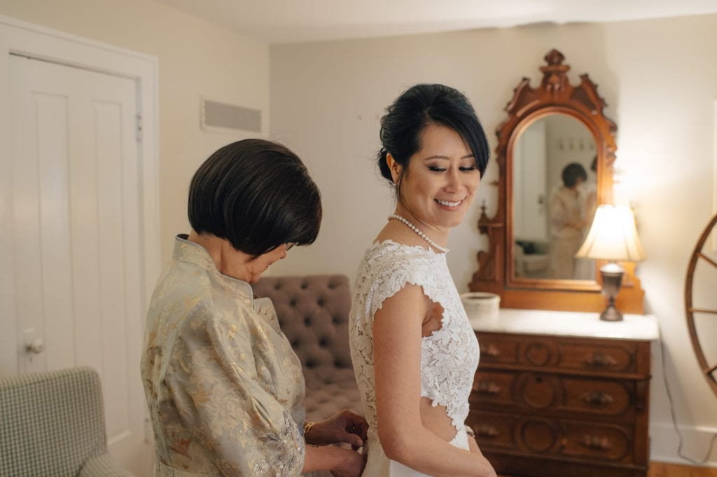 mom helping bride get ready, simply brilliant events