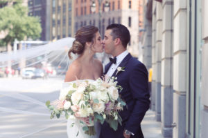 detroit wedding kiss, simply brilliant events, swooping veil