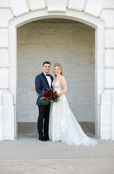 whiskey factory wedding, simply brilliant events, a married couple standing side by side