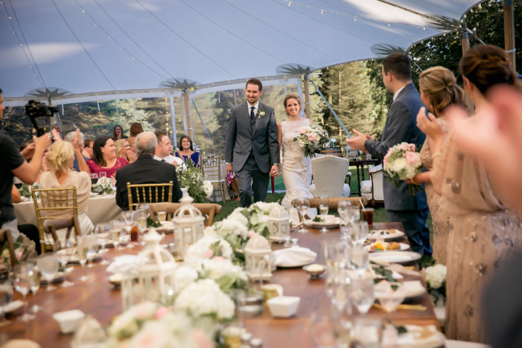 Luxury tent wedding, sailcloth tent, gold chiavari chairs and farmhouse tables