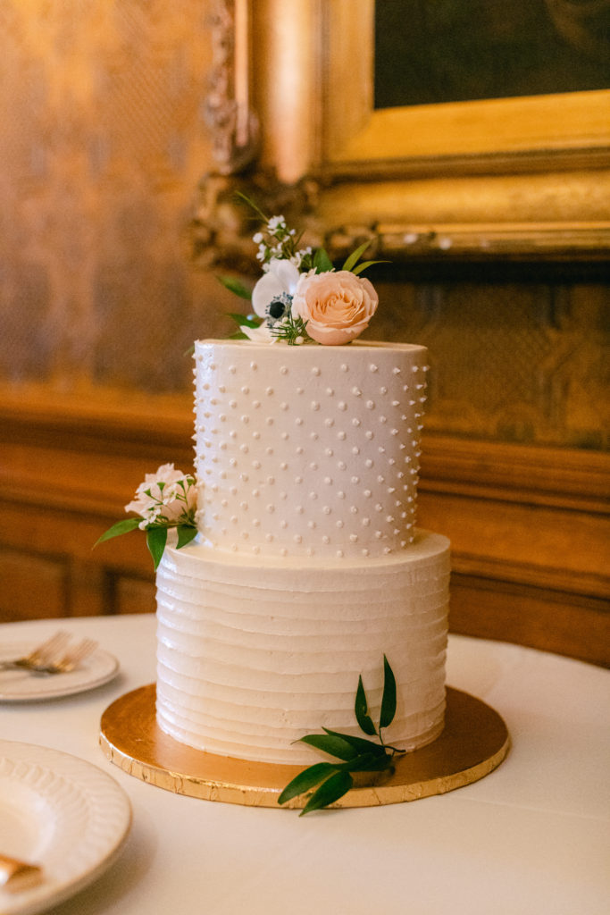 two tier decorated luxury wedding cake, with white design luxury wedding planner, simply brilliant events, wedding at The Whitney, Detroit.  Whitney  wedding