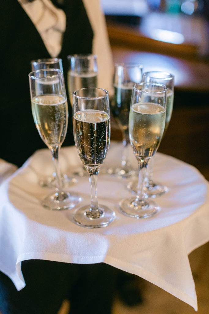 server handing out champagne, from a luxury wedding in Detroit planned by wedding planner , simply brilliant events